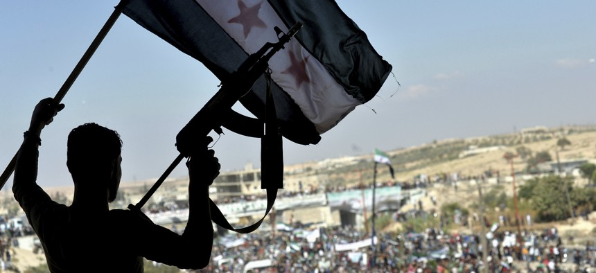 Thousands of protesters attend a demonstration against the Syrian government offensive to Idlib, in the northwestern town of Maarat al-Numan, also known as al-Maʿarra, south of Idlib, Syria, Friday, Sept 14, 2018.