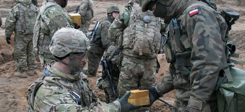 Troops assigned to the Polish Army's 2nd Engineer Battalion, 5th Engineer Regiment and the U.S. Army's 82nd Brigade Engineer Battalion, 2nd Armored Brigade Combat Team, 1st Infantry Division train together near Oleszno, Poland Nov. 27, 2017.