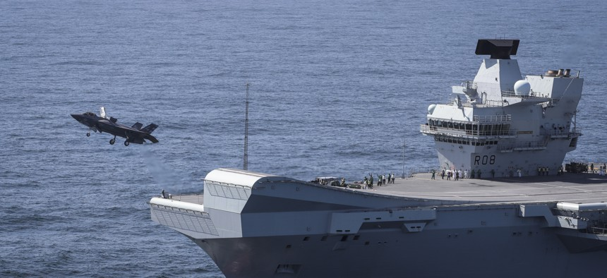 Commander Nathan Gray RN, Makes the first ever F-35B Lightning II jet take off from HMS Queen Elizabeth.