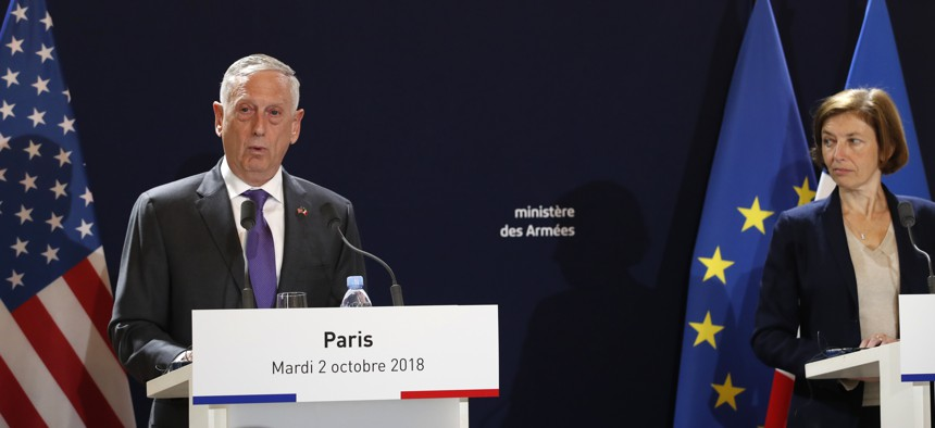U.S Defense Secretary Jim Mattis, left, and French counterpart Florence Parly attend a joint press conference in Paris, Turesday, Oct.2, 2018.