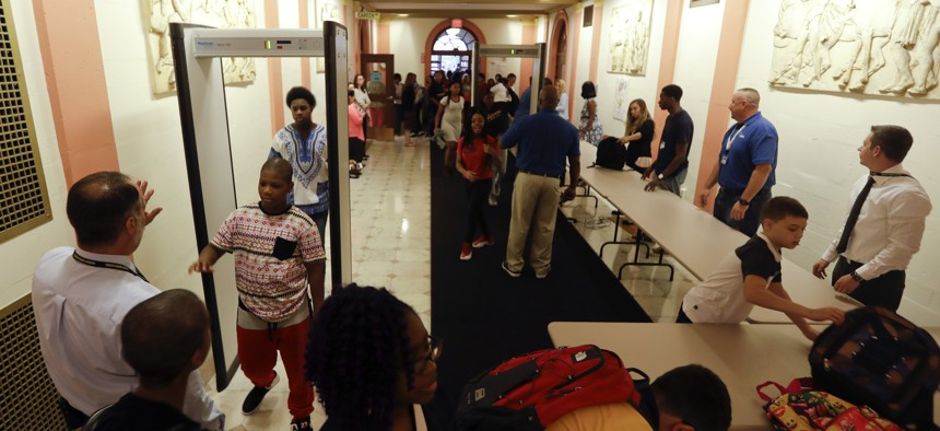 Students at William Hackett Middle School pass through metal detectors on the first day of school on Tuesday, Sept. 6, 2016, in Albany, N.Y.
