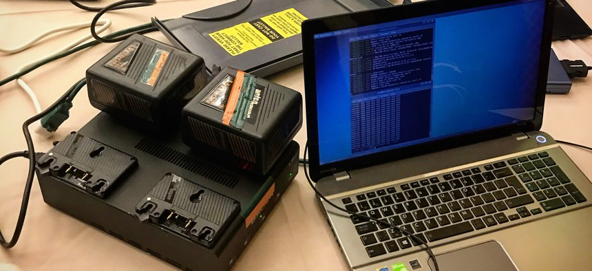 A scene from the Voter Hacking room at DEFCON 2018, where hackers were able to compromise voting machine data in less than 20 minutes.