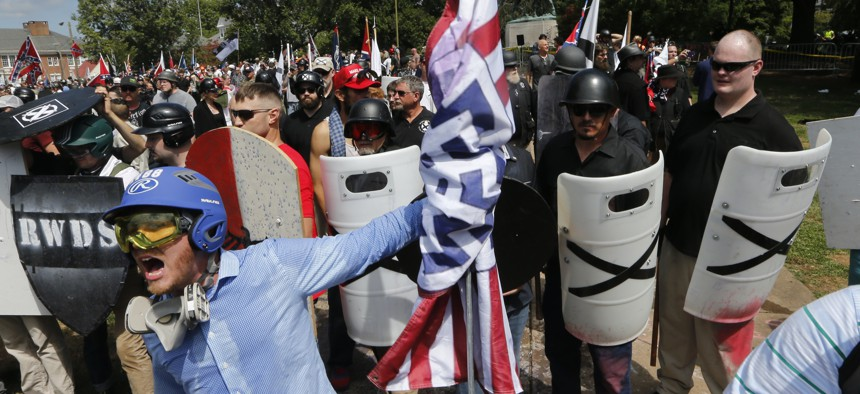 This Saturday, Aug. 12, 2017 image shows white supremacist yelling at counter demonstrators st the entrance to Emancipation Park in Charlottesville, Va.
