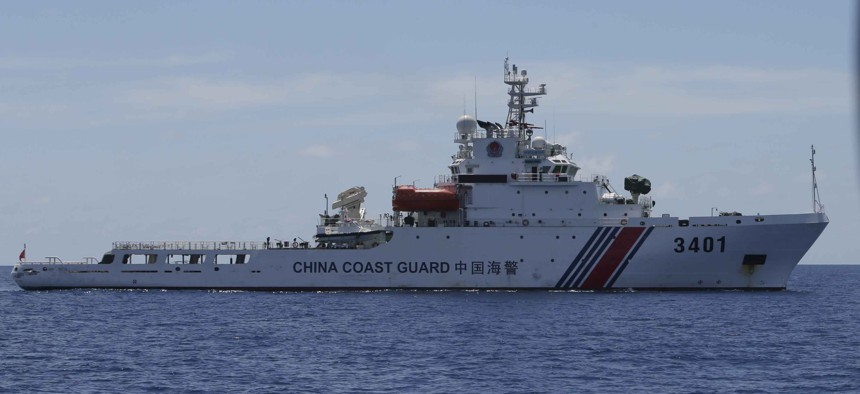 A China Coast Guard vessel attempts to block a Philippine government vessel as the latter tries to enter the China Second Thomas Disputed Shoals, locally known as name Ayungin Shoal, to orate Philippine troops and resupply provisions March 29, 2014.