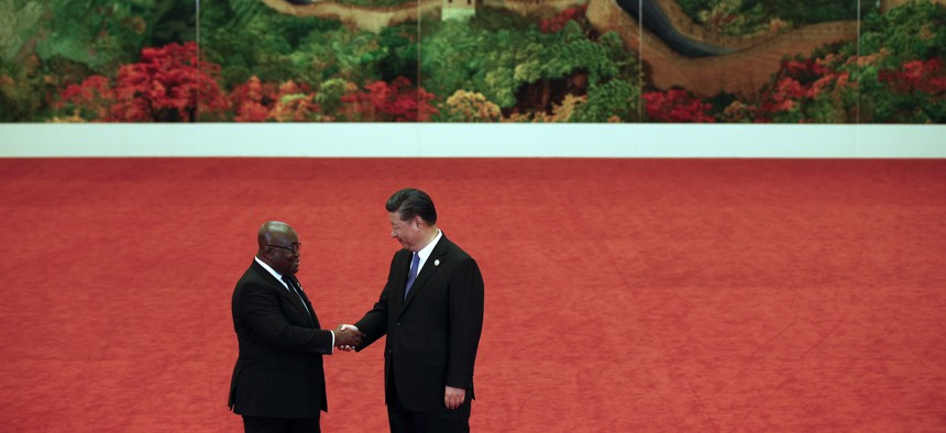 Ghana's President Nana Akufo-Addo, left, shakes hands with Chinese President Xi Jinping during the Forum on China-Africa Cooperation held at the Great Hall of the People in Beijing, Monday, Sept. 3, 2018.