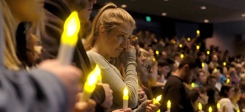 People gather to pray for the victims of a mass shooting during a candlelight vigil in Thousand Oaks, Calif., Thursday, Nov. 8, 2018.