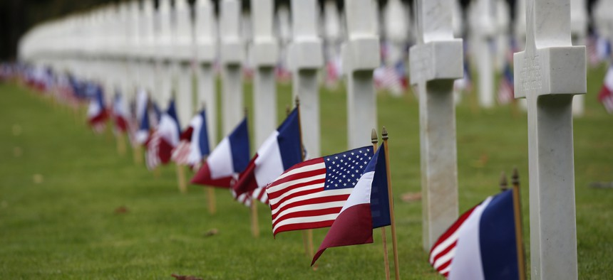 American and French flags are arranged in the Meuse-Argonne cemetery in France for a remembrance ceremony on Sept. 23, 2018.