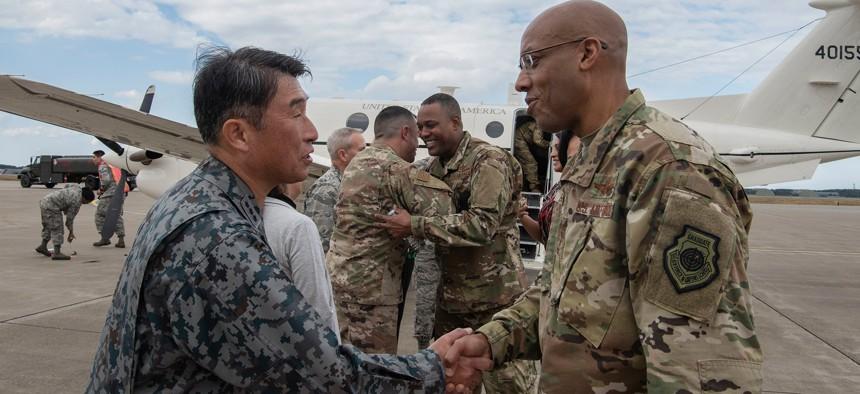 Japan Air Self-Defense Force Lt. Gen. Tamotsu Kidono and U.S. Air Force Gen. CQ Brown shake hands at Misawa Air Base, Japan.