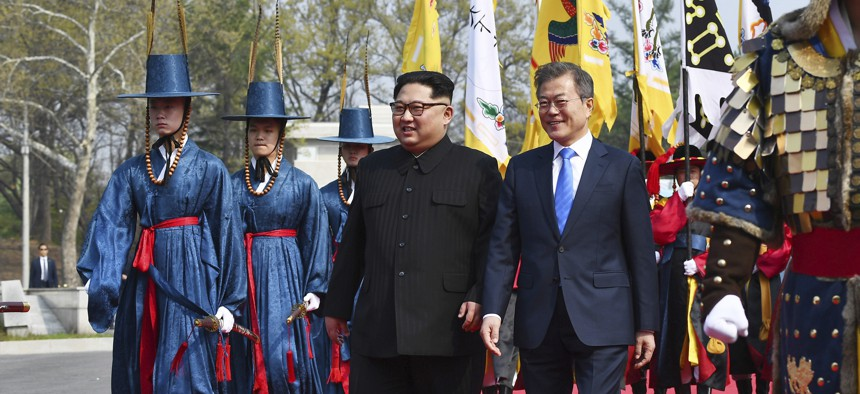 North Korean leader Kim Jong Un, left, and South Korean President Moon Jae-in walk together at the border village of Panmunjom in the Demilitarized Zone Friday, April 27, 2018.