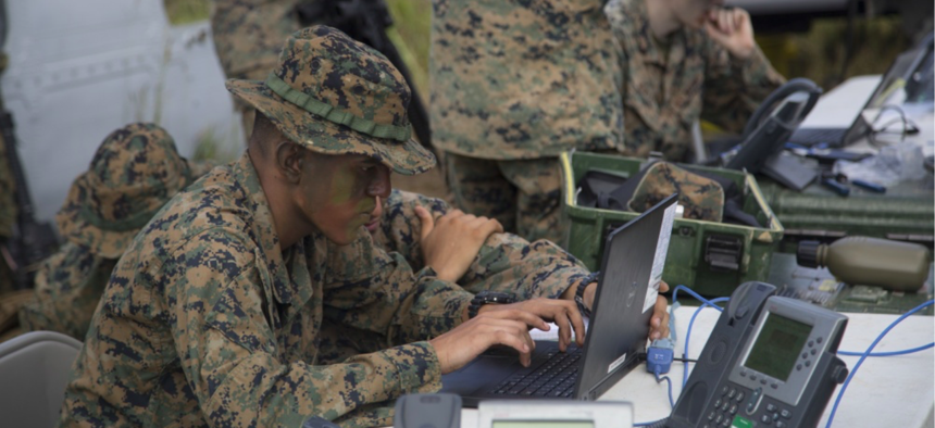 U.S. Marines compete against each other in a race to set up a working communication system during an exercise at the Jungle Warfare Training Center in Okinawa, Japan, Oct. 18, 2018.