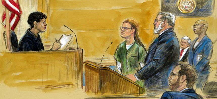 In this courtroom sketch, Maria Butina, left, is shown next to her attorney Robert Driscoll, before U.S. District Judge Tanya Chutkan, during a court hearing at the U.S. District Court in Washington, Thursday, Dec. 13, 2018.