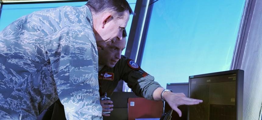 U.S. Air Force Maj. Gen. John N.T. Shanahan, 25th Air Force commander, observes the bird strike avoidance radar system inside the air traffic control tower on Offutt Air Force Base, Neb., Jan. 27.