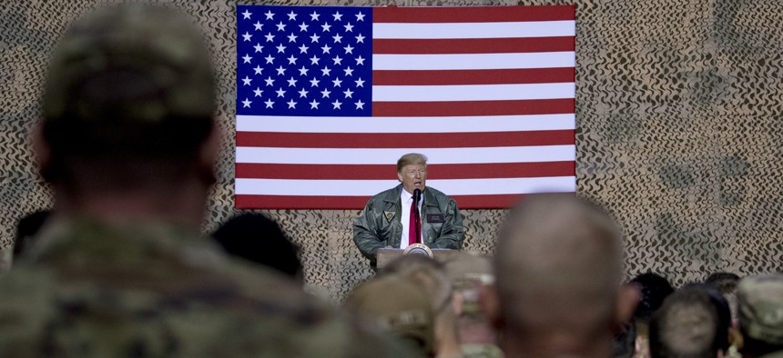 After ordering a withdrawal from Syria, President Donald Trump speaks to U.S. troops at Al Asad Air Base, Iraq, Wed., Dec. 26, 2018.