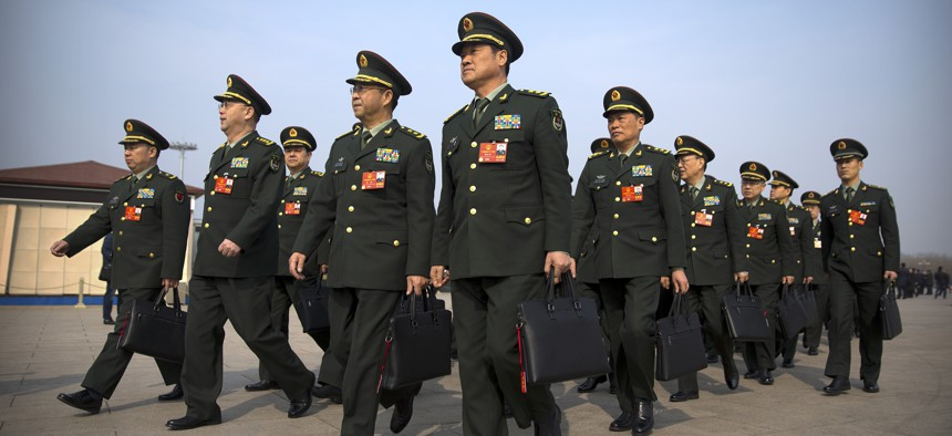 Military delegates arrive for a plenary session of China's National People's Congress (NPC) at the Great Hall of the People in Beijing, Friday, March 9, 2018.