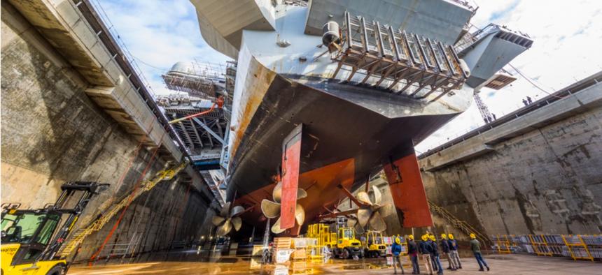 USS Nimitz (CVN 68) in Dry Dock 6 post dewatering at Puget Sound Naval Shipyard & Intermediate Maintenance Facility in Bremerton, Wash., March 5, 2018.