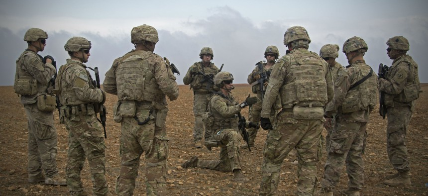 U.S. soldiers gather for a brief during a combined joint patrol rehearsal in Manbij, Syria, Nov. 7, 2018.