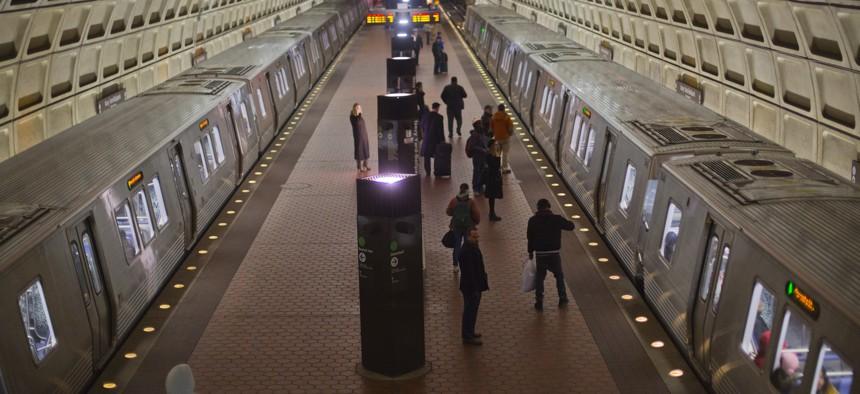 Passengers board subway trains at the Naval Yard-Ballpark Metro Station, Thursday, Feb. 8, 2018, part of the public transit network for Washington.