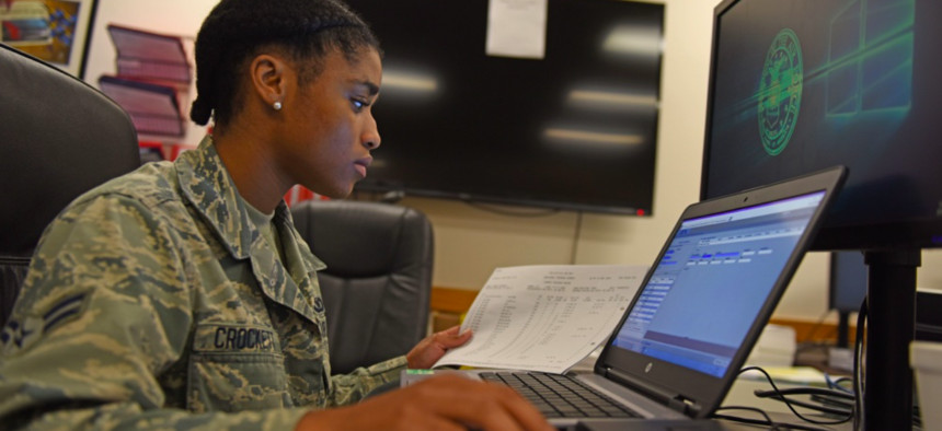 U.S. Air Force Airman 1st Class Rebecca Crockett, 77th Fighter Squadron aviation resource management journeyman, inputs an F-16CM Fighting Falcon pilot's flying hours into a database at Shaw Air Force Base, S.C., Aug. 6, 2018.