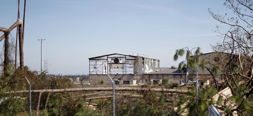 An airplane hangar at Tyndall Air Force Base, which was not included in DOD's climate change report, is damaged from hurricane Michael in Panama City, Fla., Thursday, Oct. 11, 2018.