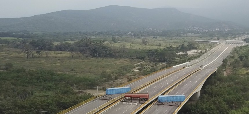 Trailers and cargo containers block the Tienditas International Bridge in an attempt to stop humanitarian aid entering from Colombia on Feb. 6, 2019. Immigration authorities say the Venezuelan National Guard built the roadblock a day earlier.