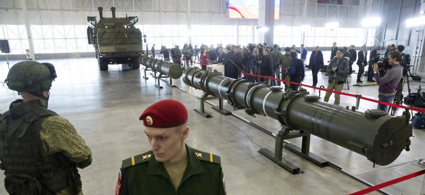 Russian military officers stand by as the 9M729, center, its launcher, left, and the 9M728, right, land-based cruise missiles are displayed in Kubinka outside Moscow, Russia, Wednesday, Jan. 23, 2019.