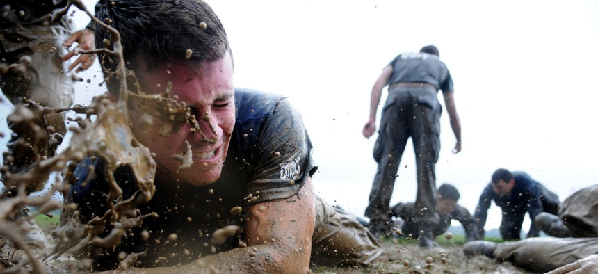 A first-year midshipman, or plebe, is splashed with mud while participating in Sea Trials May 15, 2012, at the U.S. Naval Academy in Annapolis, Md.