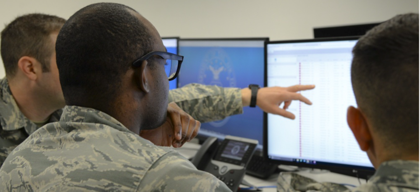 Tacet Venari (latin for silent hunt) participants apply skills learned at the first U.S. Air Forces in Europe cyber-only exercise during the practical application portion of training at the Warrior Preparation Center on Einsiedlerhof Air Station, Germany.