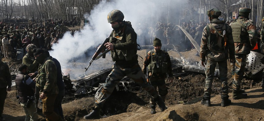In this Wednesday, Feb.27, 2019 file photo, Indian army soldiers arrive at the wreckage of an Indian helicopter after it crashed killing several in the Budgam area, on the outskirts of Srinagar, Indian controlled Kashmir.
