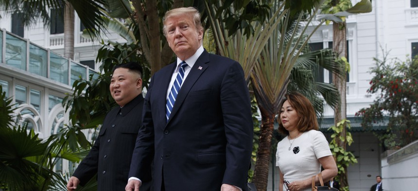 President Donald Trump and North Korean leader Kim Jong Un take a walk at the Sofitel Legend Metropole Hanoi hotel, Thursday, Feb. 28, 2019, in Hanoi.