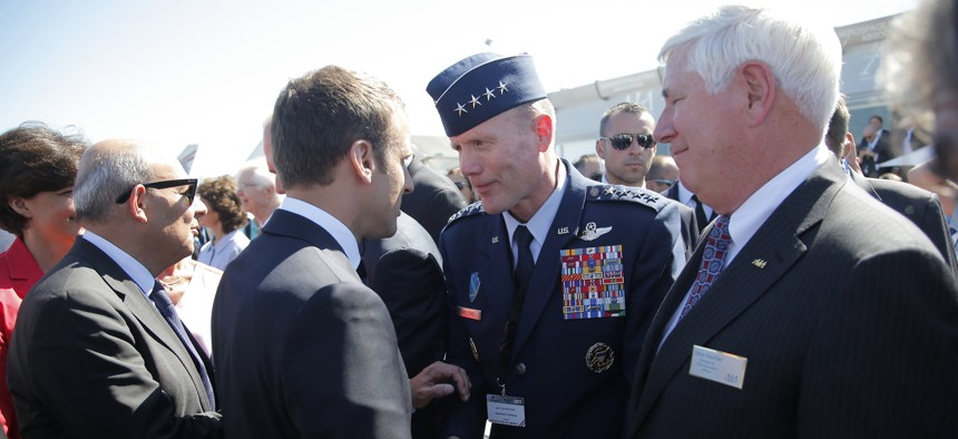 French President Emmanuel Macron, meets with Gen Tod D. Wolters, commander of the US Air Forces in Europe, 2nd right, while visiting the Paris Air Show in Le Bourget, north of Paris, Monday, June 19, 2017.
