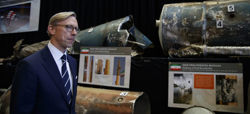 Brian Hook, U.S. special representative for Iran, walks past fragments of Iranian short range ballistic missiles (Qiam) at the Iranian Materiel Display (IMD) at Joint Base Anacostia-Bolling, in Washington, Thursday Nov. 29, 2018.