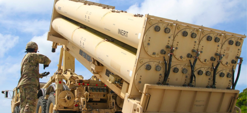 U.S. Army Cpl. Rogelio Argueta, Patriot Launching Station Enhanced Operator-Maintainer, assigned with Task Force Talon, 94th Army Air and Missile Defense Command gives commands, during a practice missile reload at Andersen Air Force Base, Feb. 6, 2019.