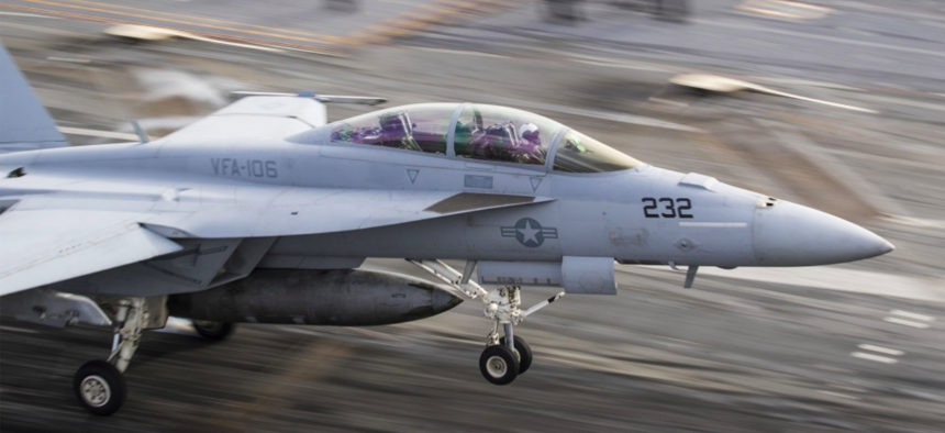 An F/A18 Super Hornet, assigned to the Romans of Strike Fighter Squadron (VFA) 106, lands on the flight deck of the aircraft carrier USS George Washington (CVN 73).