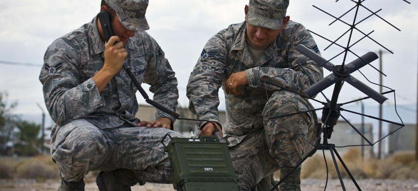 5G wireless technology might replace older radios like this one operated by two airmen in 2013 at Nellis Air Force Base, Nev.
