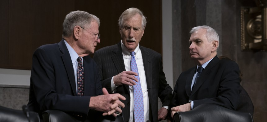 From left, Senate Armed Services Committee Chairman Jim Inhofe, R-Okla., Sen. Angus King, I-Maine, and Ranking Member Jack Reed, D-R.I., confer before a hearing on the Pentagon budget, on Capitol Hill in Washington, March 14, 2019.