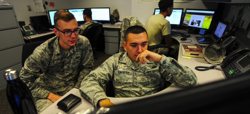 U.S. Air Force cyber security technicians with the 355th Communications Squadron review work orders at Davis-Monthan Air Force Base Ariz., Sept. 26, 2018.