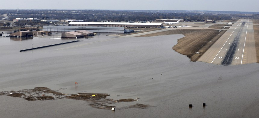 This March 17, 2019 photo shows an aerial view of Offutt Air Force Base and the surrounding areas affected by flood waters in Neb.