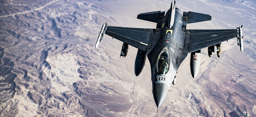 A U.S. Air Force F-16C Fighting Falcon pilot maneuvers to refuel from a KC-135 Stratotanker over Afghanistan on March 11, 2018.
