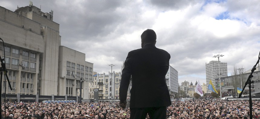 Ukrainian President Petro Poroshenko speaks to a crowd ahead of the presidential elections on April 21, at the Olympic stadium in Kiev, Ukraine, Sunday, April 14, 2019.