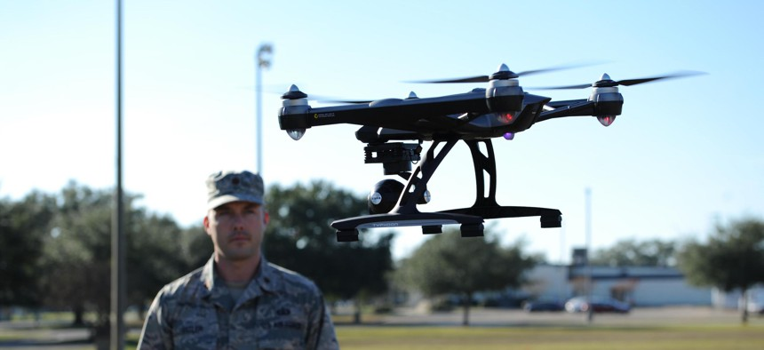 Air Force Maj. Joshua D. Pitler, 81st Operations Support Flight commander, flies a drone at Keesler Air Force Base in 2015.