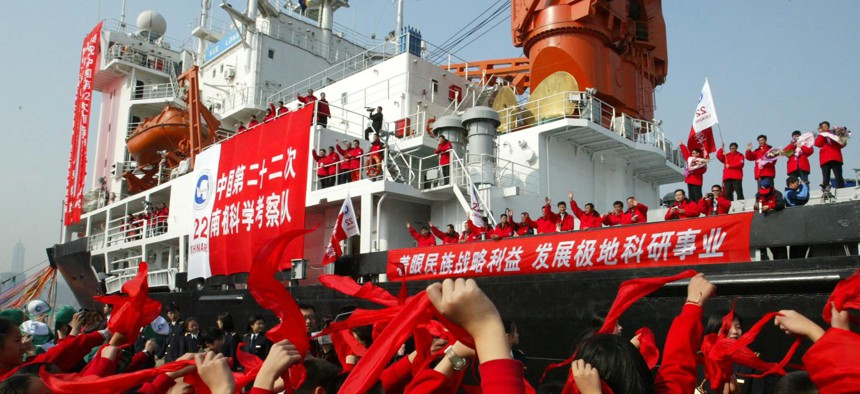 Students waves to members of the Chinese Antarctica Research Team aboard the polar expedition ship Xuelong as they leave Shanghai in east China Friday, Nov. 18, 2005.