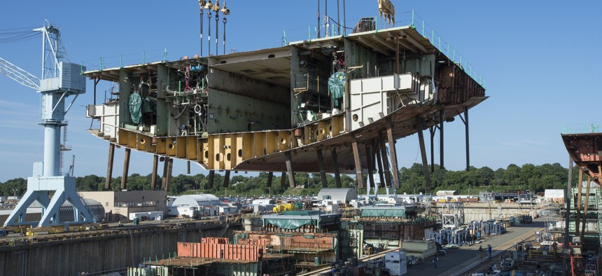Newport News Shipbuilders lifted a 704-metric-ton aunit into Dry Dock 12, where construction of the aircraft carrier USS John F. Kennedy (CVN-79) is taking shape.