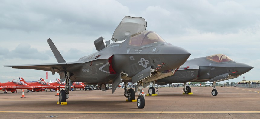 A US Marine Corps F-35B sits in front of a US Air Force F-25A at the 2016 Royal International Air Tattoo, Fairford, UK.