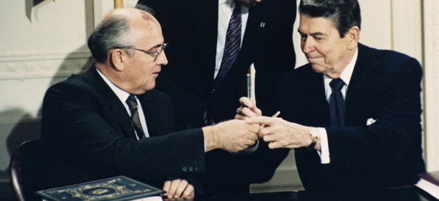 In this Dec. 8, 1987, file photo U.S. President Ronald Reagan, right, and Soviet leader Mikhail Gorbachev exchange pens during the Intermediate Range Nuclear Forces Treaty signing ceremony in the White House East Room in Washington, D.C.