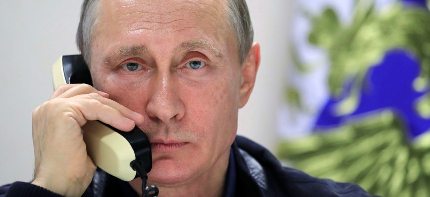 Russian President Vladimir Putin speaks over the phone with Turkish President Recep Tayyip Erdogan aboard the pipelaying vessel Pioneering Spirit in the Black Sea near Anapa, Russia, Friday, June 23, 2017.