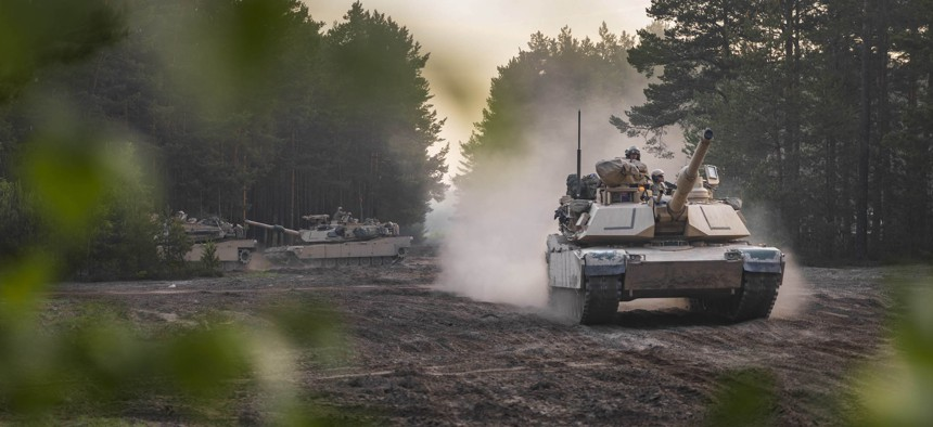 Soldiers aboard Army M1A2 Abrams tanks move out during an initial ready task force exercise at Johanna Range near Zagan, Poland, May 20, 2019.