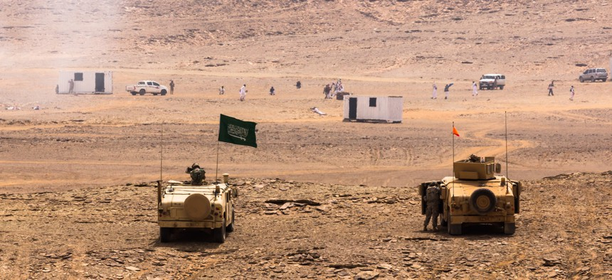Royal Saudi Land Forces (RSLF) and U.S. Army soldiers from 4th Infantry Division assault a mock town after an  on April 13, 2014, near Tabuk, Saudi Arabia.