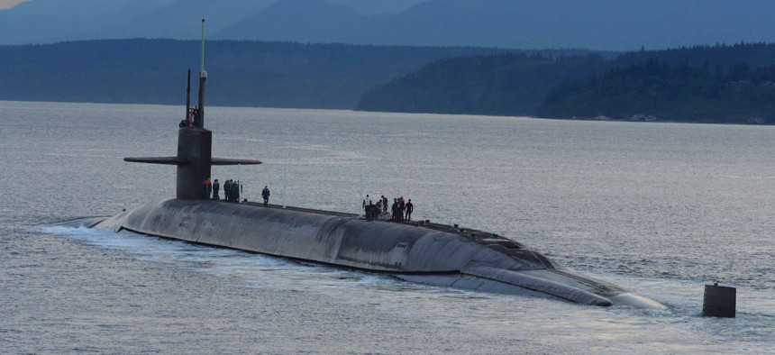 The ballistic-missile submarine USS Henry M. Jackson (SSBN 730) arrives home at Naval Base Kitsap-Bangor following a strategic deterrent patrol in 2015.