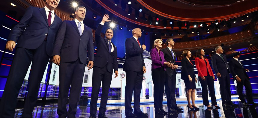 Candidates pose on stage before the Democratic primary debate hosted by NBC News, Wednesday, June 26, 2019, in Miami.