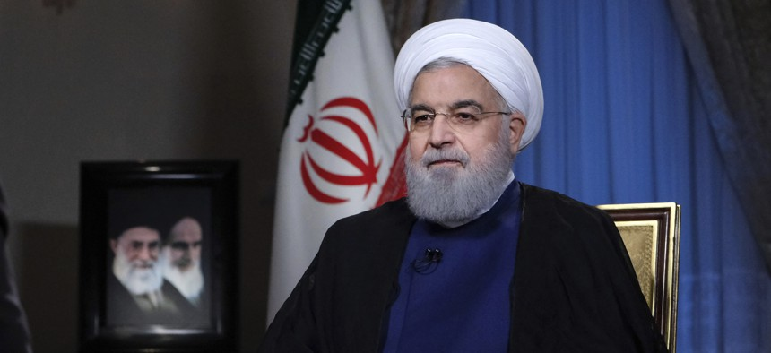 In this photo released by official website of the office of the Iranian Presidency, President Hassan Rouhani addresses the nation in a televised speech in Tehran, Iran, Monday Aug. 6, 2018